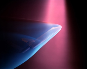 A beautiful photograph of the Space Shuttle in a wind tunnel at a high supersonic Mach number with shock waves illuminated by electron-beam fluorescence. Image from FYFD. Click to go to the post.
