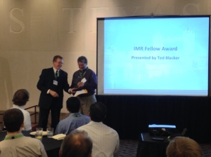 Sandia's Ted Blacker (left) presents the IMR Fellow award to Tim Tautges (right). If they appear to be laughing, it's because Ted dropped the glass plaque and broke it.