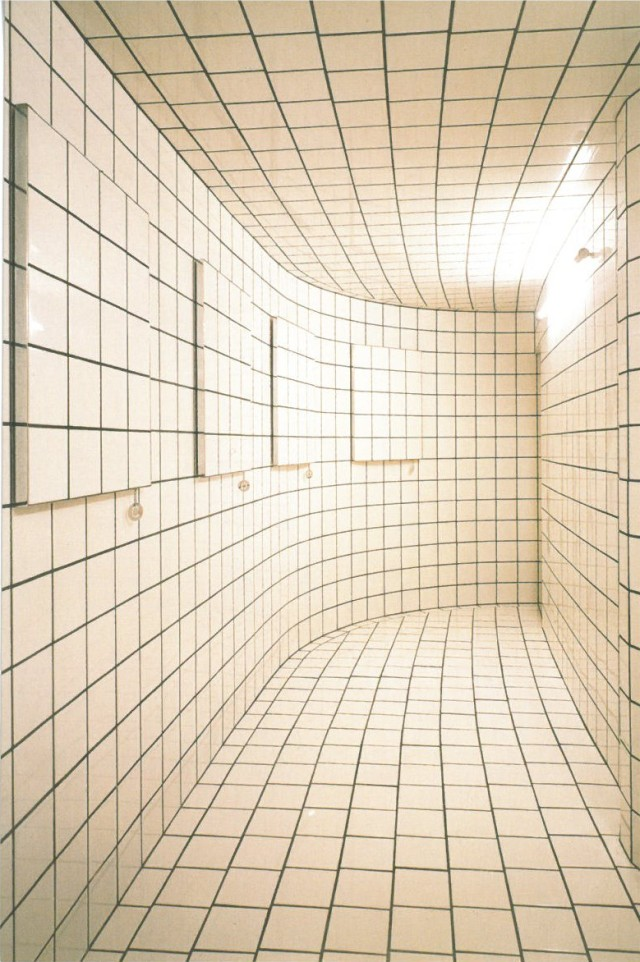 This is Jean Pierre Raynaud's installation L'Espace Zero in Tokyo's Hara Museum of Contemporary Art. Being inside this room is oddly disorienting due to the slight curvature and the bright light.